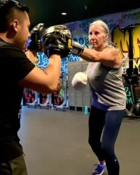 Personal Trainer and older woman boxing - Fit In 42 Studio Gym