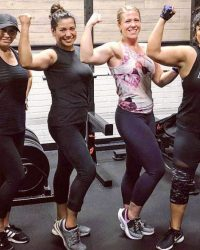 Fit In 42 Fitness Gym - Lean mommy makeover - Female members flexing strong smiling