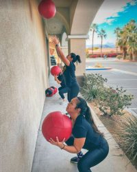 Fit In 42 Fitness Gym - Lean mommy makeover - Female members working outside with medicine ball on the wall