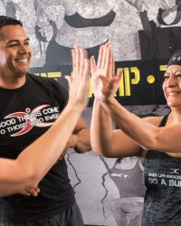 Fit In 42 Fitness Gym - Lean mommy makeover - Trainer and female members giving a team high-five
