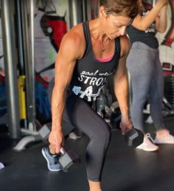 Fit In 42 Fitness Gym - Female member with hand weights