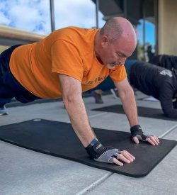 Fit In 42 Personal Trainer and Studio Gym - Fit Over 50 30 Day Workout Challenge - Man doing push-ups