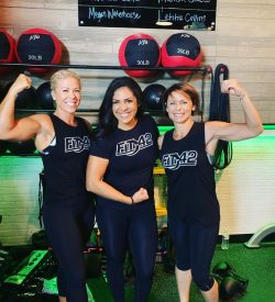 Fit In 42 Personal Trainer and Studio Gym - Fit Over 50 30 Day Workout Challenge - Ladies flexing with trainer