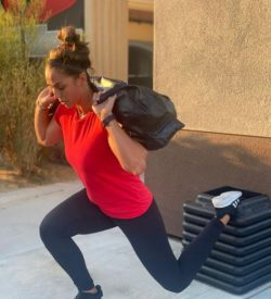 Woman outside workout with heavy bad and steps - Fit In 42 Studio Gym