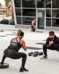 Personal Trainer and woman squats with masks outdoors- Fit In 42 Studio Gym